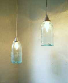 kitchen ideas...pendants over the bar made from old mismatched glass bottles...character!
