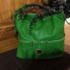 Authentic Dooney and Bourke kelly green bag Authentic Dooney and Burke kelly green Pebble leather hobo handbag. This soft leather handbag is in great condition only worn once. However it has several minor scratches on the exterior of said bag and one pin mark. Duster bag included. Dooney & Bourke Bags Shoulder Bags