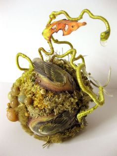 Yellow Warbler Biotope, Amy Gross, fabric, paper, beads, wire, embroidery and thread, approximately 4 inches high, free-standing