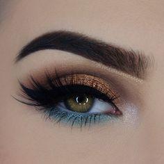 dramatic wing eye makeup blue eyeliner gold eyeshadow perfect eyelashes gorgeous style glam makeup