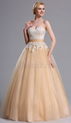 Crafted of the softest, lightest tulle, this evening ball dress is incredibly stunning. This utterly romantic applique gown is almost too chic to handle. Fluffy champagne tulle creates a lovely ombre effect, while a sweetheart neckline dials up the drama. The tulle girdle and open back accent its feminine look.