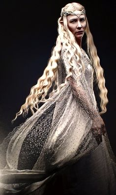 'At the White Council, Galadriel wears a coat in shot silk, woven with a metallic thread that magically catches the light. I originally drew the coat as if it were blowing in the wind, hoping that it would create an ethereal, enigmatic vision of Galadriel. While waiting for a decision on the design, we made up the coat and photographed it on a model and it looked beautiful.'  -Ann Maskrey on Dressing Galadriel