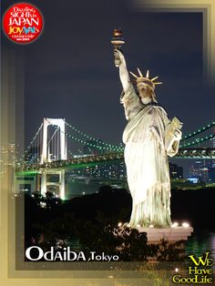 the replica of Statue of Liberty in Odaiba, and with the background of Rainbow Bridge. .