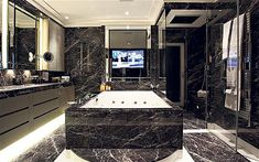 """Unashamedly opulent"" is how the estate agent describes this bathroom.  It has a 55 inch-wide bath, monsoon shower, steam room and 40 inch television, all set in black marble."