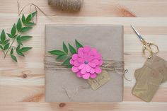 brown paper with fuchsia flower