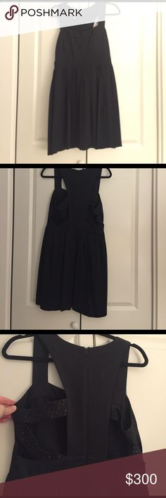 Black twinkle by wenlan dress Twinkle by wenlan black party dress. Great condition. Size 10. Cut out detailing on back. Anthropologie Dresses Midi