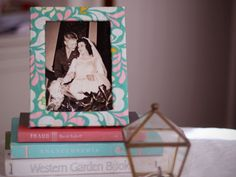 We all love to display photos, but fancy frames can be pricey. They don't have to be, though! With a thrifted frame and some pretty fabric you can add a pop of spring color to your desk or bookshelf.