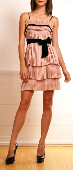 Pink pleated dress with black bow & trim.