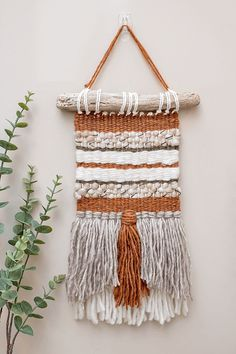 Create your own beautiful woven wall hanging with this detailed step by step tutorial that is perfect for beginner weavers.