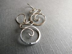Simple in their design, but classy in their look, the Sterling Silver Swirl earrings are elegant and light weight! Thick sterling silver is hand formed, textured by hammering to reflect the light. Ear