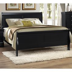 Enhance your home's transitional style with this wooden sleigh bed from Lyke Home. The classic silhouette draws inspiration form the timeless design of 18th century France, while the black finish make