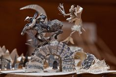 Mystery book sculptor returns -- News: The anonymous artist who caused a stir has opened a fresh chapter of filigree scissor work -- Robert Burns poem Tam O'Shante