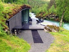 The hotel's spa space is set right into the banks on the rushing Valldola. The turf roof seems like a contemporary conceit but in fact is a reference to ancient Scandinavian tradition of sod roofs.  Courtesy of Robert Landon.