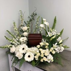 Send Evans White Garden Cremation Wreath in Peabody, MA from Evans Flowers, the best florist in Peabody. All flowers are hand delivered and same day delivery may be available. Casket Flowers, Grave Flowers, Funeral Flowers, Funeral Floral Arrangements, Modern Flower Arrangements, Vase Arrangements, Funeral Sprays, Funeral Urns, Funeral Reception