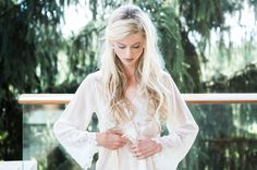Triple Sister New York Wedding // long blonde windswept hair curls in a lace getting ready robe