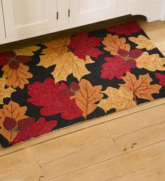 Falling Leaves Indoor/Outdoor Accent Rug | Accent Rugs - Ready to celebrate the fall season, this accent rug's festive design features autumn leaves and acorns against a black background.