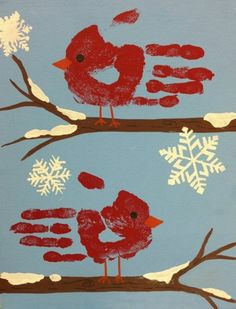 zwei rote vögel und scghneeflocken  handabdruck bilder