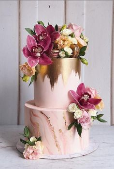 ・・・ Classy wedding cake brushed freehandedly with edible gold, marbled design on bottom tier, completed with cymbidiums and various blooms here and there by 💗💗 _ Crazy Wedding Cakes, Summer Wedding Cakes, Creative Wedding Cakes, Floral Wedding Cakes, Wedding Cakes With Cupcakes, Elegant Wedding Cakes, Beautiful Wedding Cakes, Wedding Cake Designs, Beautiful Cakes