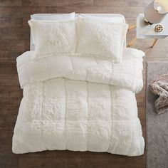 Stay warm and cozy with the Intelligent Design Malea Shaggy Faux Fur Comforter Set. Crafted with comfort in mind, this unique comforter features a shaggy fur texture both on top of and underneath the covers, paired with matching shams. Fur Comforter, Faux Fur Bedding, Black Comforter, Twin Xl Comforter, Comforter Cover, Queen Comforter Sets, Duvet Cover Sets, Fluffy Bedding, Purple Bedding