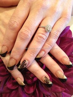Black and gold freehand rose nail art