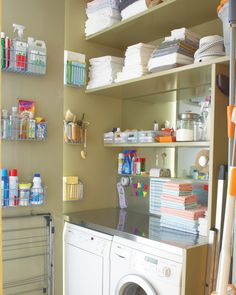 Mountain-high piles of clothes? Not here. The key to this laudry room is treating it as a clean-and-care center for clothing: that includes storing kits for minor sewing repairs, stain removal, and shoe care. Everything is kept within easy reach on the lowest shelf. A catchall holds popped buttons, loose change, and other forgotten pocket items. Overhead shelving separates clean loads from the dirty.