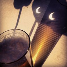 Sunday night's solar eclipse passes over a pint of New Belgium Dig Pale Ale.