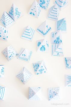 A pile of little triangle boxes to use as my advent calendar. Love the doodles!   www.1dogwoof.com