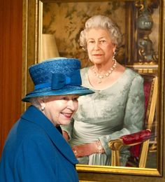Queen Elizabeth looking at a painting of herself.