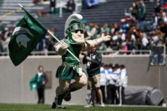 Sparty, runs out onto the field before the Michigan State spring football game at Spartan Stadium in East Lansing Saturday, April 26, 2014. The White team won the game, 20-13. (Mike Mulholland   MLive.com)
