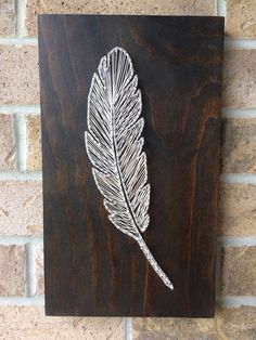 A personal favorite from my Etsy shop https://www.etsy.com/ca/listing/521479044/string-art-feather-white-wood-birds