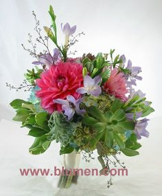 Bride's bouquet with blue hydrangea, pink dahlias, lavender freesia, succulents, seeded eucalyptus and variegated pittosporum; Blumengarten Florist, Pittsburgh, PA; www.blumen.com