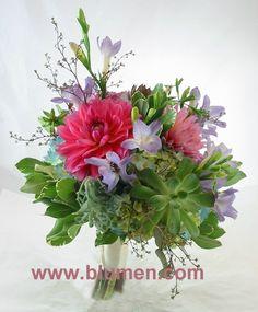 Bride's bouquet with blue hydrangea, pink dahlias, lavender freesia, succulents, seeded eucalyptus and variegated pittosporum; Blumengarten Florist, Pittsburgh, PA; www.blumen.com