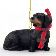 You will love our Dachshund dog ornaments! They are adorably accessorized with a festive Christmas scarf. Each resin figurine is hand painted to include all those life like details of your favorite breed. These ornaments are the larger version of our popular scarf ornaments. They measure approximately 2.5-3″ in their longest direction.