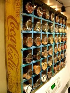 A vintage Coca-Cola crate turned on its side becomes handsome storage for spices.