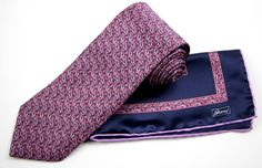 The perfect pair in this BRIONI Navy Pink Abstract Floral Silk Necktie Tie Pocket Square Set!  |  Go shopping! http://www.frieschskys.com/accessories/ties-pocket-squares/ties  |  #instastyle #mensfashion #mensstyle #menswear #dapper #stylish #MadeInItaly #Italy #couture #highfashion
