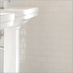 white subway tile, maybe a strip of beige or gray to break it up. add color with textiles, pictures, etc.