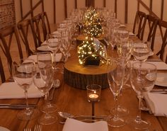 Long rustic trestle tables with wooden slice, terrarium and pealight table centres with crossback chairs for a rustic woodland wedding at Upwaltham Barns by www.stressfreehire.com #venuetransformers