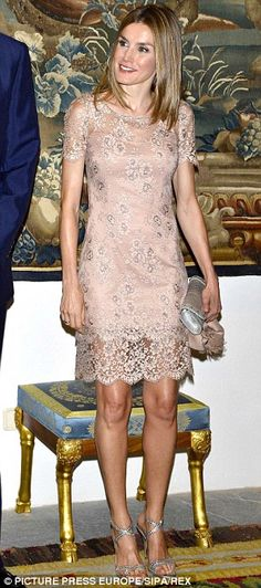 Elegant: Princess Letizia is chic in a nude lace dress at the Almudaina Palace in Palma