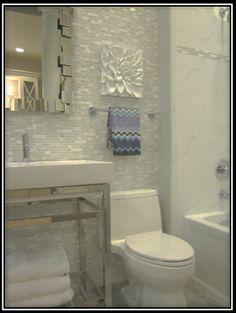 white marble bathroom with Missoni towel