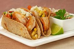 Shrimp Tacos with Corn and Avocado Salsa: A light, flavorful taco filled with sautéed shrimp and a fresh salsa made with corn, tomato, avocado, jalapeño, cilantro and lime.
