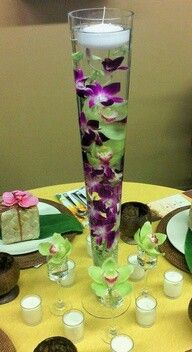omg caro now im looking at stuff id like for my one day wedding this is beautiful lol featuring submerged purple dendrobium orchids and green cymbidium orchids with floating candle Party Centerpieces, Wedding Decorations, Submerged Centerpiece, Centerpiece Wedding, Flower Centerpieces, Table Arrangements, Floral Arrangements, Purple Wedding, Wedding Flowers
