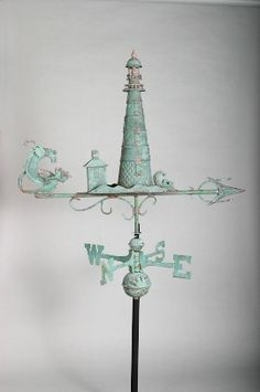 lighthouse weather vane