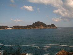 Nekozaki peninsula , looks like looks like a kewpie lying on its back.  (Hyogo, Japan)