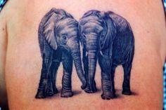 Just because Ella LOVES Elephants lol  Elephant Couple Tattoo Design