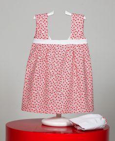 Vestido con estampado floral. Corte bajo pecho con detalle en blanco. Cubrepañales a juego. www.chatitaonline.com