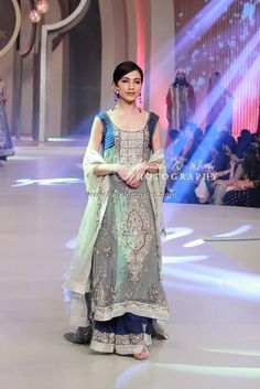 Amna Ajmal Bridal Dresses at Bridal Couture Week 2013. Love the architectural detail, and the color palette is beautiful.
