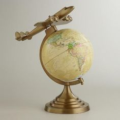 One of my favorite discoveries at WorldMarket.com: Antique Brass Plane Globe $59.99