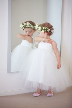 oh so cute little flower girl in white tulle dress with a flower crown