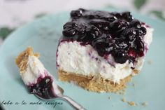 These creamy no-bake cheesecake bars feature a thick graham cracker crust and is topped with a sweet blueberry sauce made from fresh blueberries.