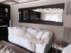 ocean road sofa, bleached teak root coffee table, homenature live edge mirror, petrified wood side table.